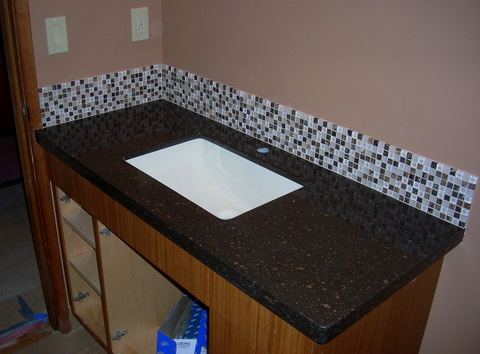 Counter and back splash in downstairs bath